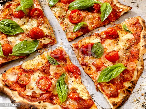 Margherita Pizza with Fresh Mozzarella,Tomatoes and Basil - Photographed on a Hasselblad H3D11-39 megapixel Camera System