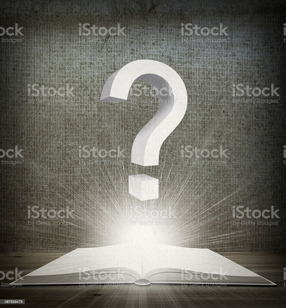 Over an open book is question mark stock photo