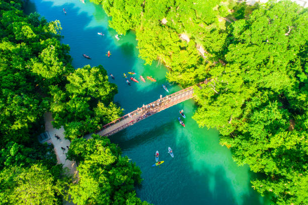 Over Barton Creek Bridge Austin Texas Summer Sunshine Aerial Drone view above Over Barton Creek Bridge Austin Texas USA Summer Sunshine colorado river stock pictures, royalty-free photos & images