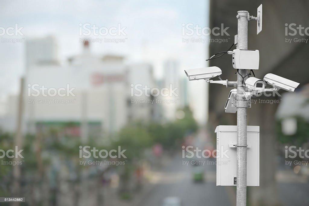 CCTV over blurry cityscape stock photo