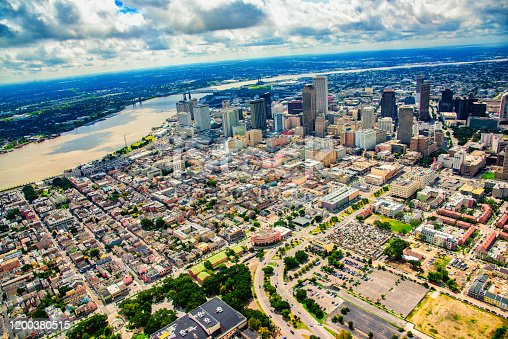 The city skyline of New Orleans, Louisiana, beyond the famed French Quarter directly below from an altitude of about 1000 feet.