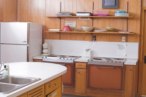 Over due of retro wood paneled kitchen
