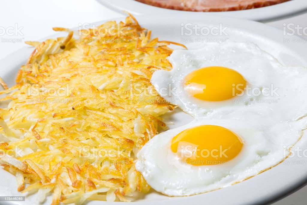 Over Easy Fried Eggs and Hash Browns stock photo