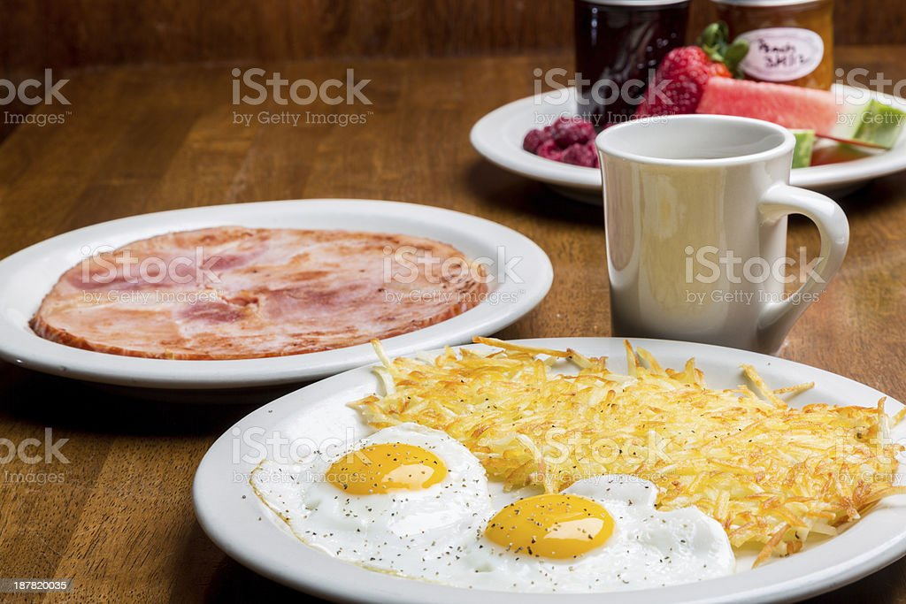 Over Easy Fried Eggs, Ham, Coffee and Hash Browns royalty-free stock photo