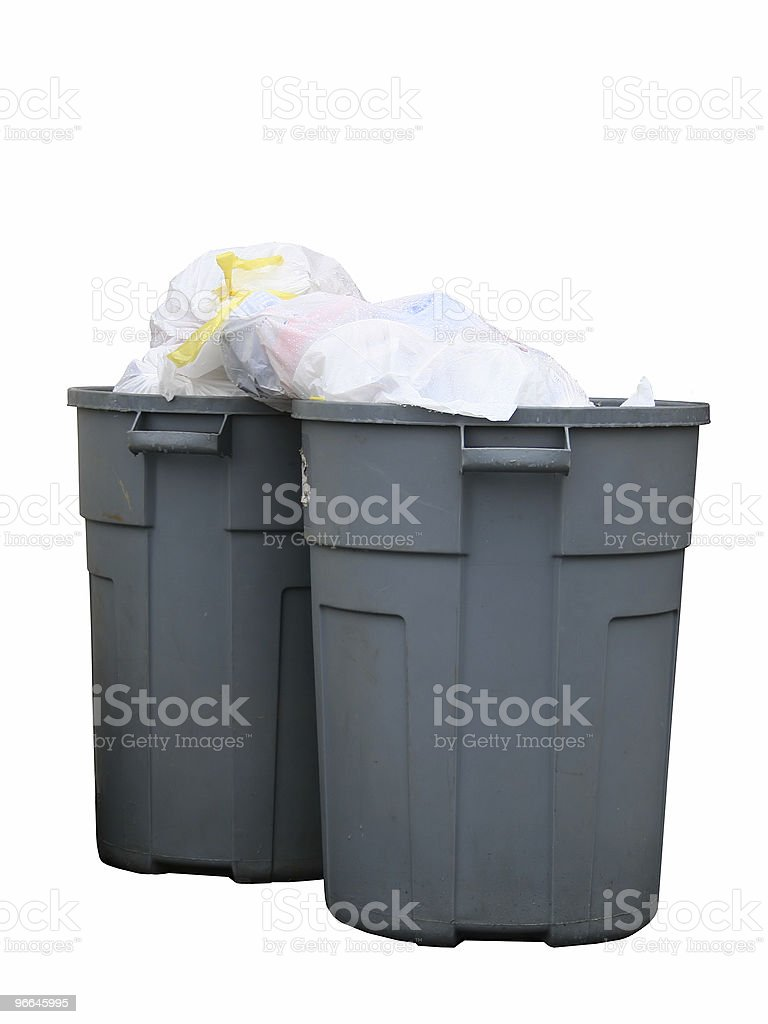 Over Filled Trash Cans in the Rain royalty-free stock photo