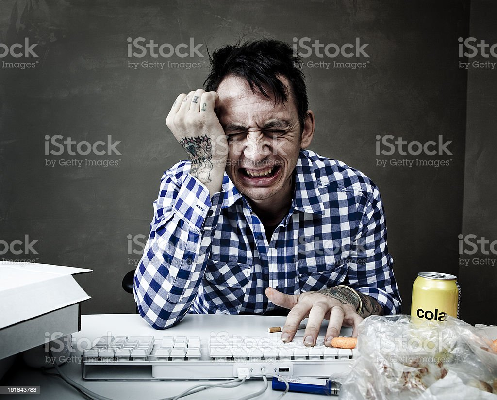 Over Stressed man crying at his computer desk royalty-free stock photo