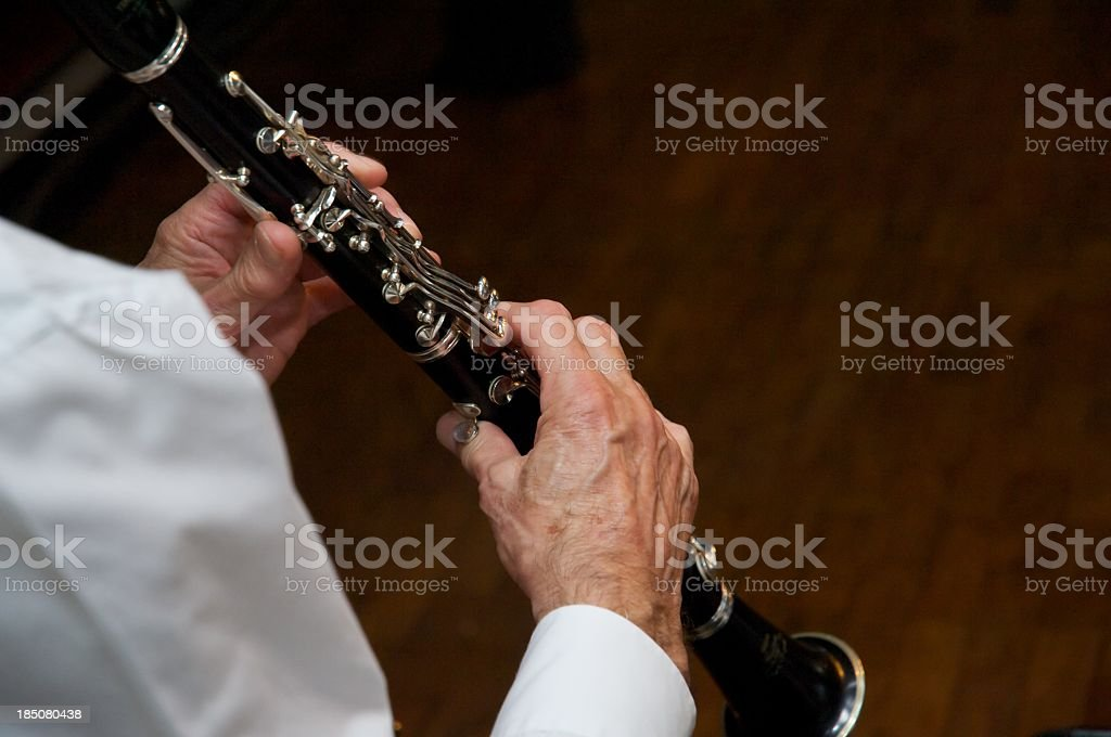 Over the shoulder photo of a clarinet player's hands stock photo