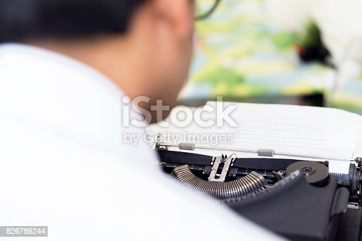 istock Over the shoulder view of a writer at work 826786244