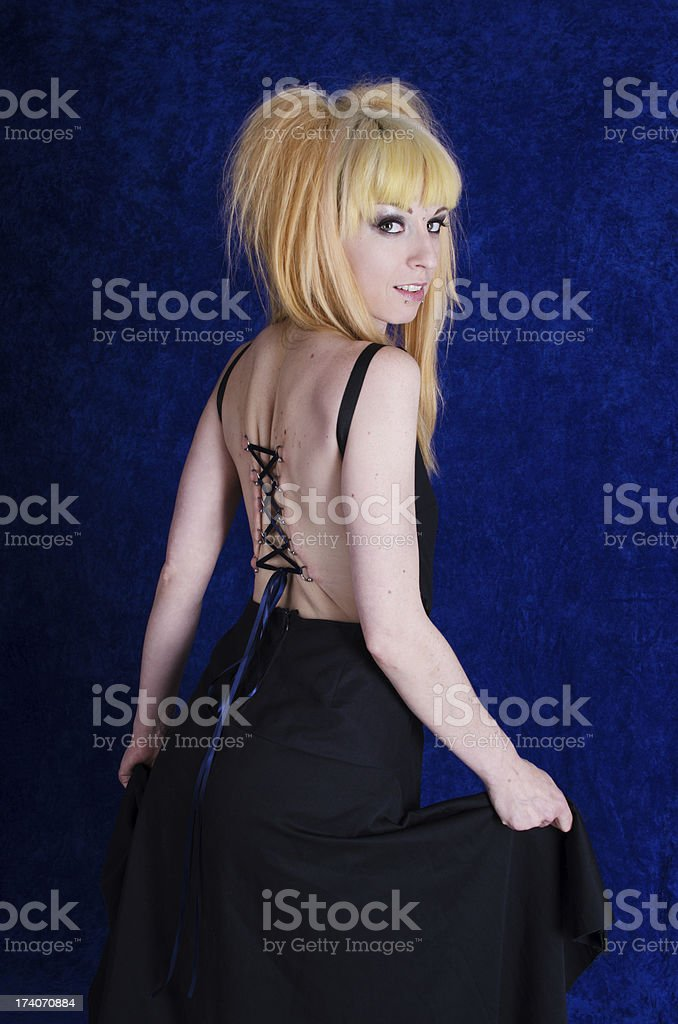 Over the shoulder view of woman with corset piercing. stock photo