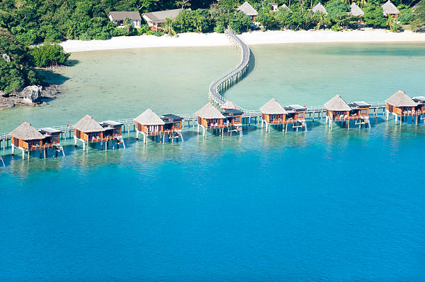 over water bungalow resort - fiji stock photos and pictures