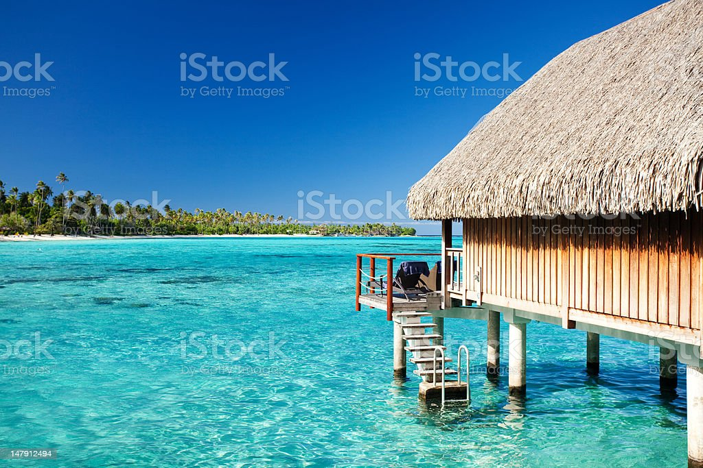 Over water bungalow with steps into lagoon royalty-free stock photo