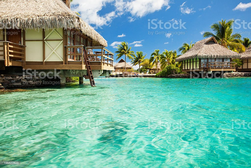 Over water bungalows with steps into amazing lagoon royalty-free stock photo