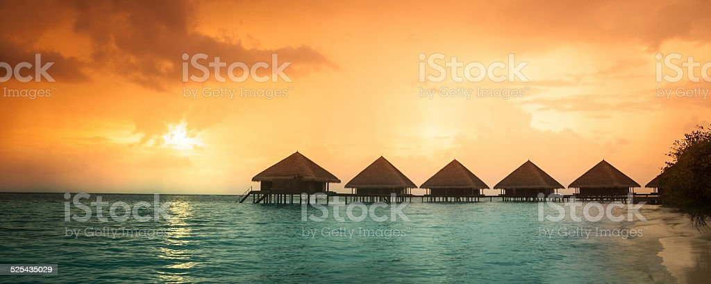 Over water bungalows with steps stock photo