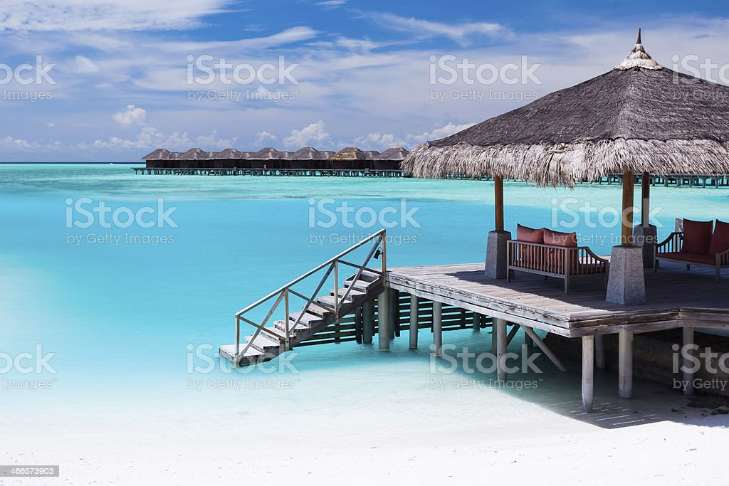 Over water jetty with steps into tropical lagoon stock photo