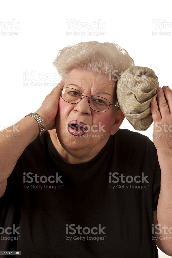 Over weight senior woman with headache, ice bag against head royalty-free stock photo