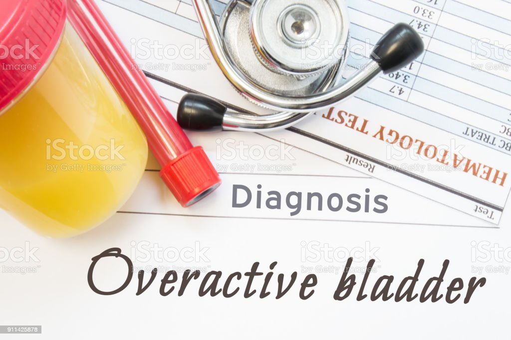 Overactive Bladder diagnosis. Container with urine sample, tube with blood, stethoscope and blood test results hematology on white note inscribed with diagnosis of urologic disease Overactive Bladder stock photo