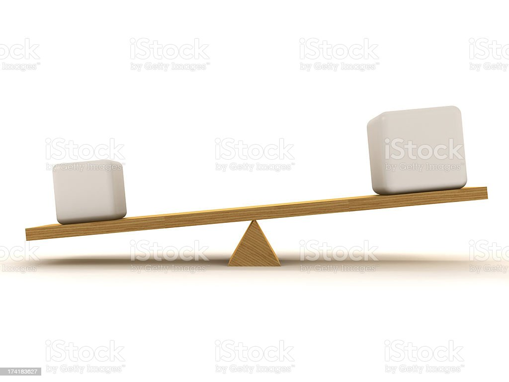 Overbalance between small and big cube stock photo