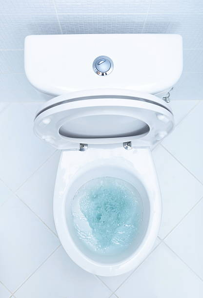 Overboard view of toilet being cleaned Toilet in the bathroom flushing water stock pictures, royalty-free photos & images