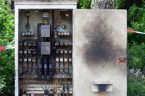 overburdened circuit board - fuse box stock photos and pictures