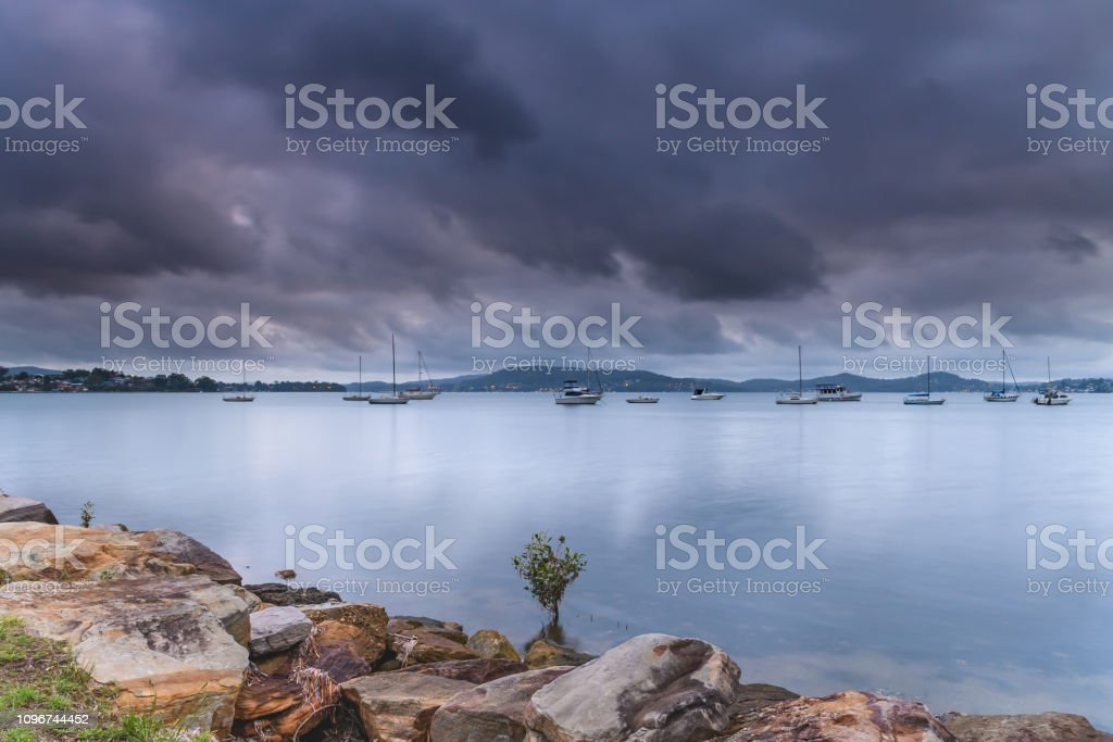 Overcast and Cloudy Bay with Boats stock photo