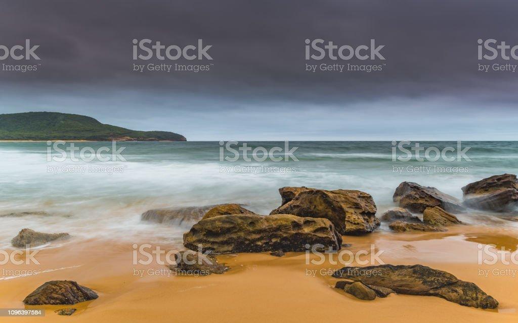 Overcast and Wet Morning Sunrise Seascape stock photo