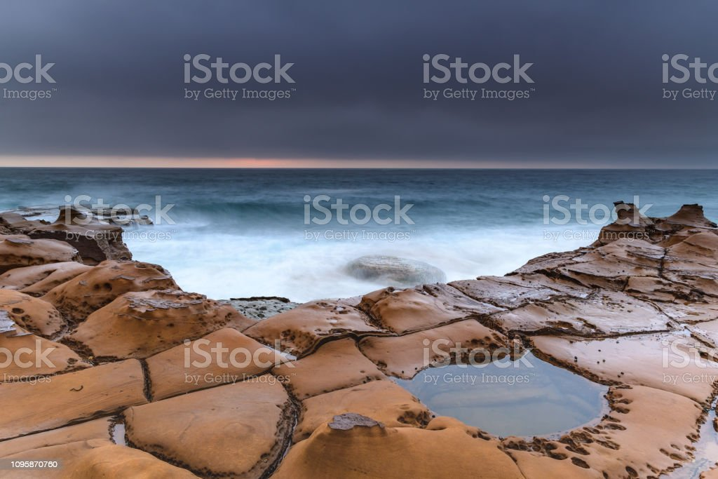 Overcast Coastal Seascape from Sandstone Headland stock photo