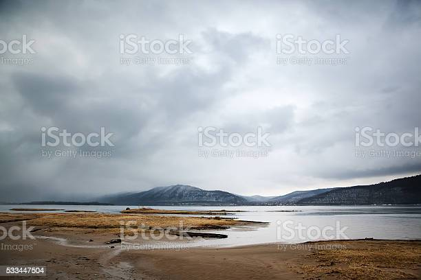 Photo of Overcast landscape. River and mountans.