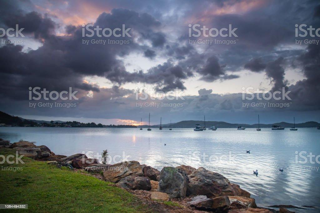 Overcast Sunrise Waterscape stock photo