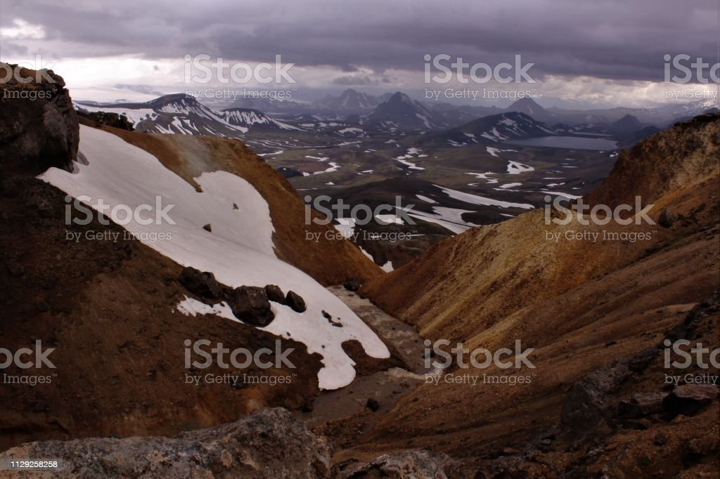 Landscape image taken early summer when the snow still melts. The...