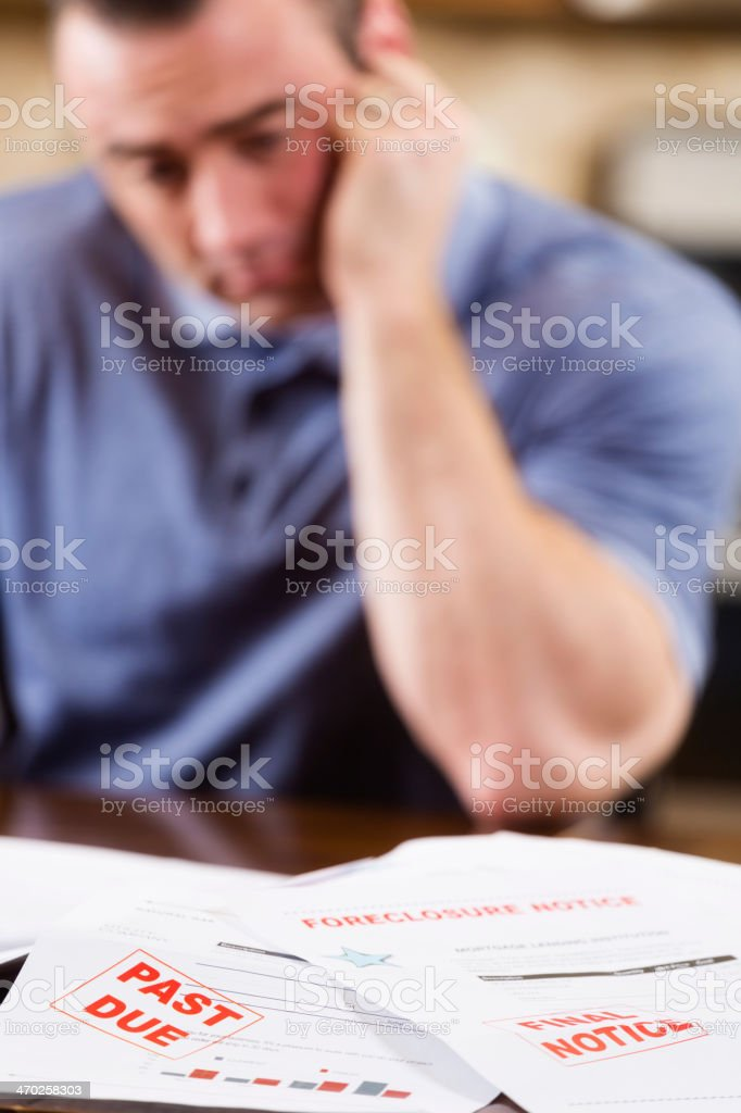 Overcome with Debt stock photo