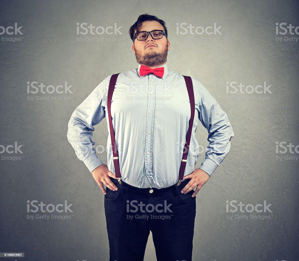 Overconfident chubby man in bowtie stock photo