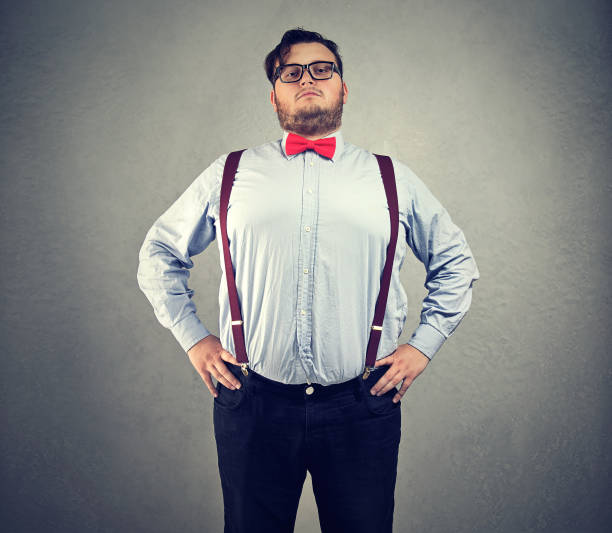 Overconfident chubby man in bowtie stock photo