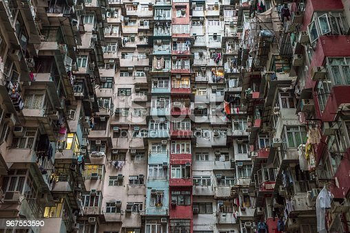 istock Overcrowded residential building in Hong Kong 967553590