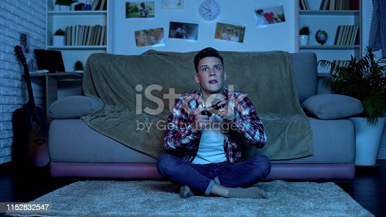 Overemotional teenager plating video game, unstable and uncontrolled emotions