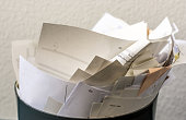 Overfilled recycle bin with paper