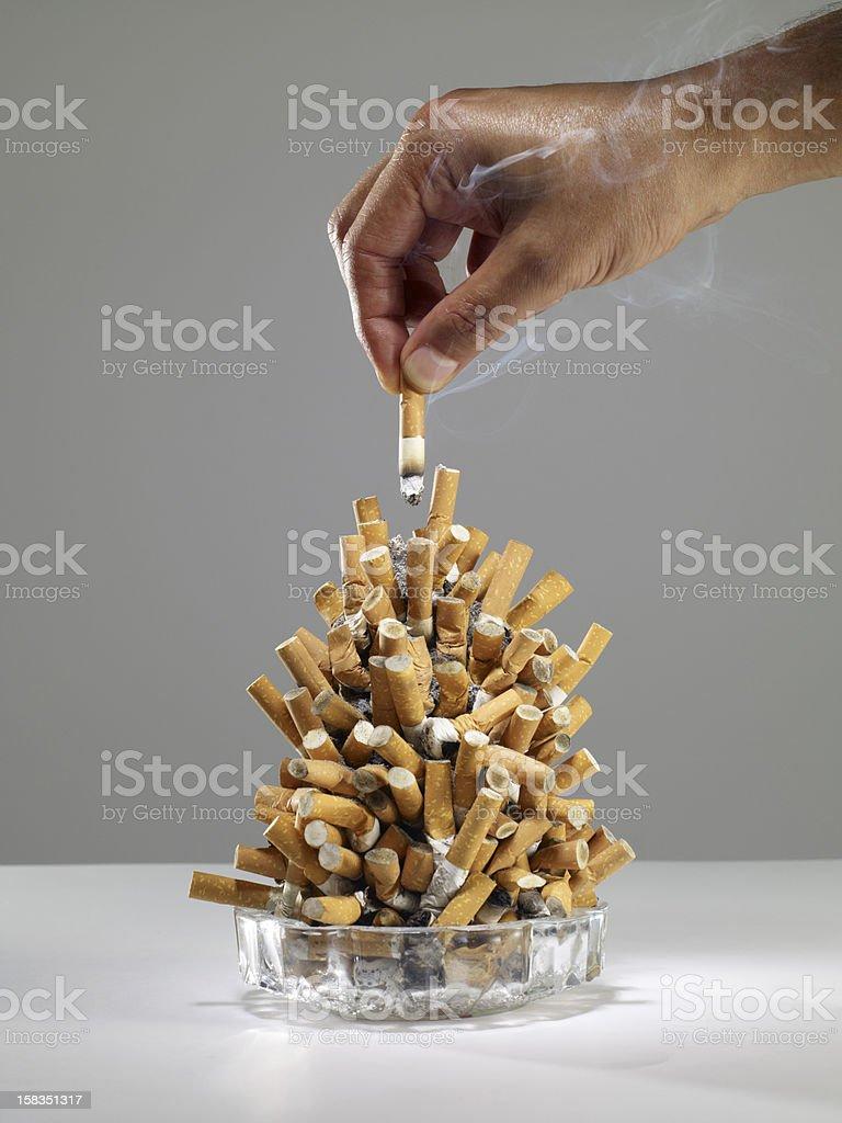 overflowing ashtray stock photo