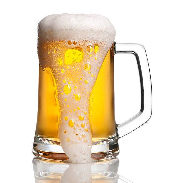 overflowing beer - beer foam stock photos and pictures
