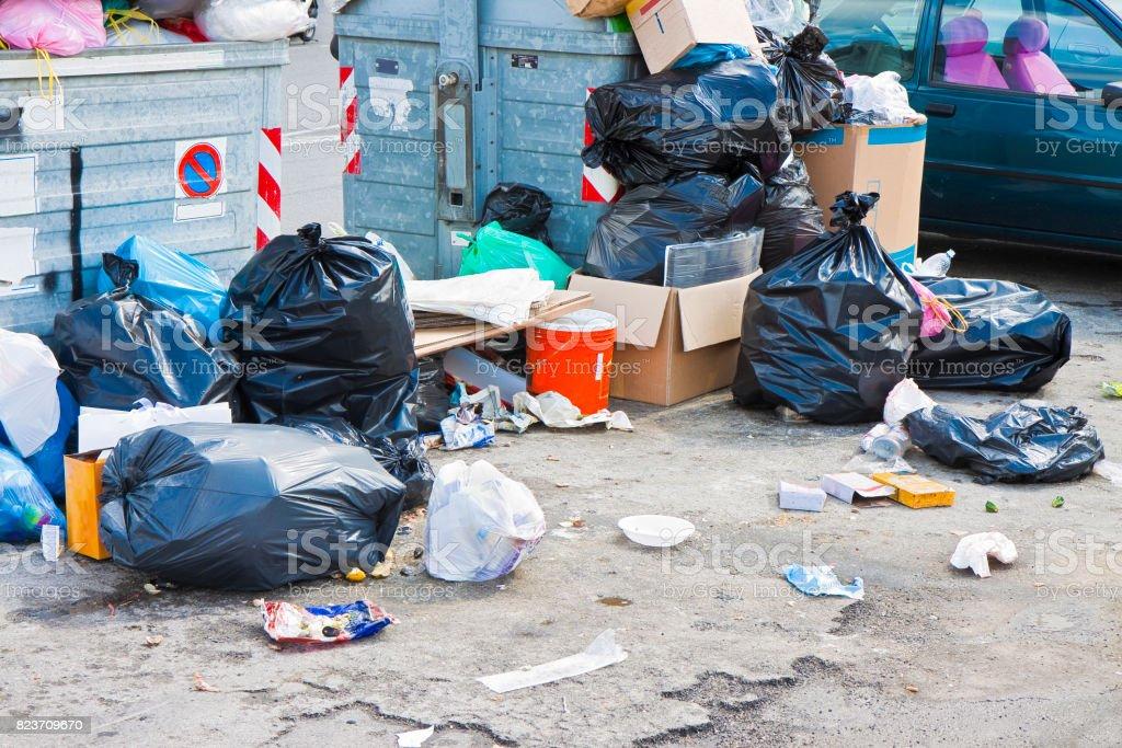 Overflowing garbage bins in a urban road stock photo
