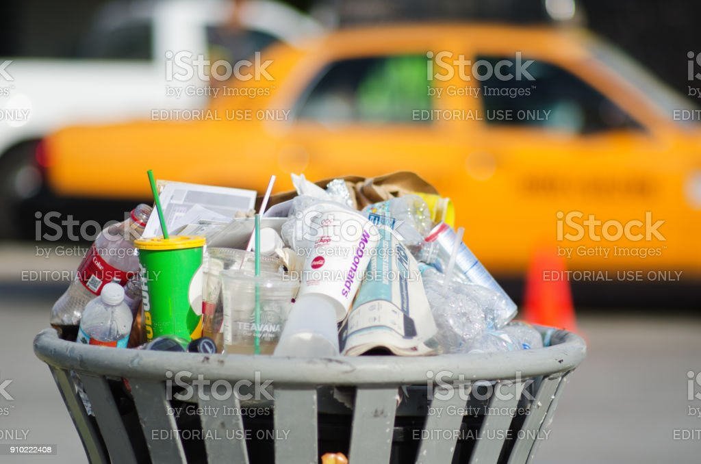Overflowing Garbage Can on the Street of Miami Florida USA stock photo