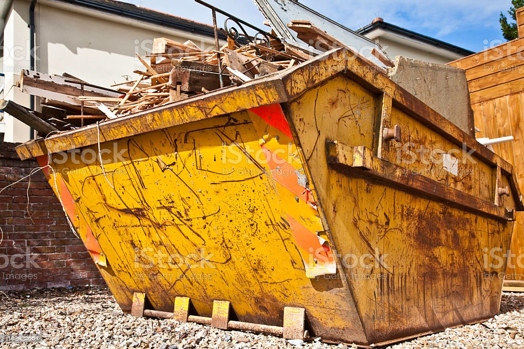 Overflowing industrial bin filled with wooden scraps royalty-free stock photo