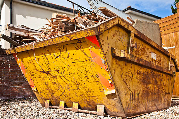 Overflowing industrial bin filled with wooden scraps stock photo