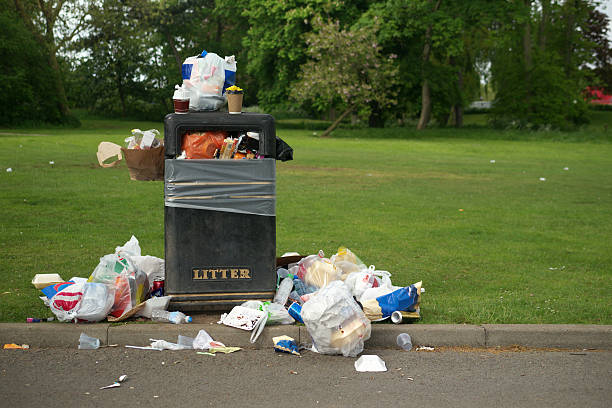 Overflowing litter bin. stock photo