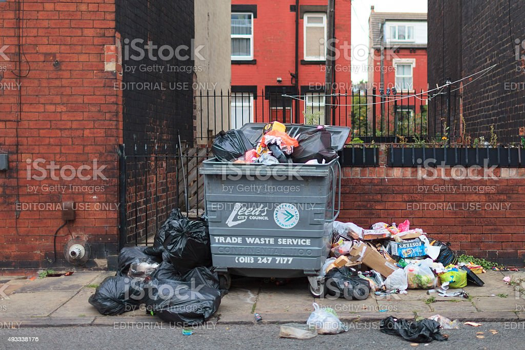 Overflowing rubbish in the street stock photo