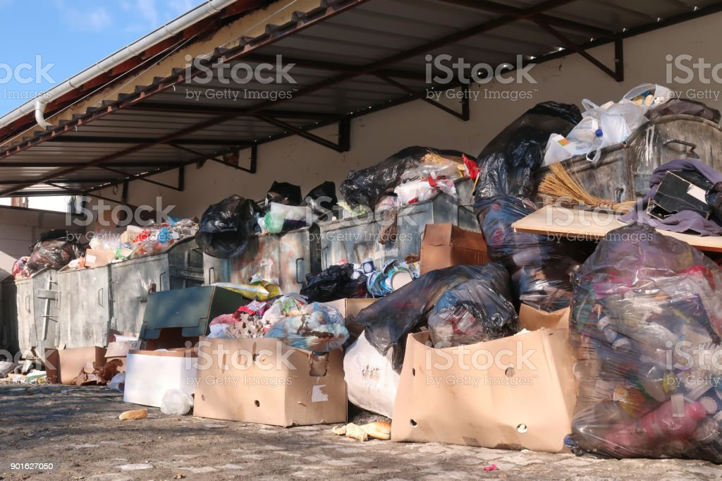 Overflowing trash containers stock photo