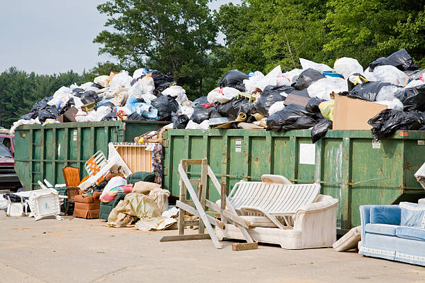 overflowing trash dumpsters one stock photo