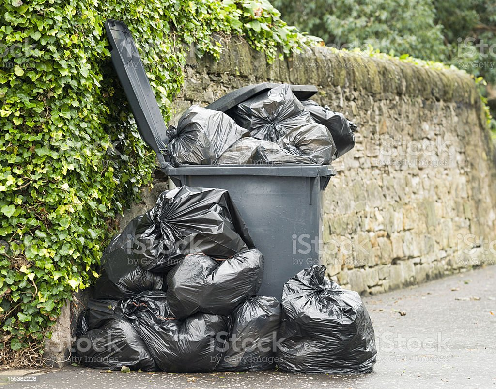 Overflowing Wheelie Bin stock photo