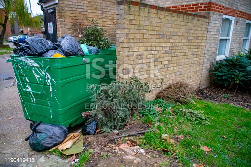 Domestic waste overflowing and dumped onto the back-streets of a Camden estate, North London.