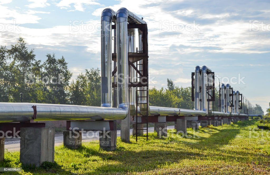 Overground heat pipes. Pipeline above the earth conducting heat for heating city stock photo