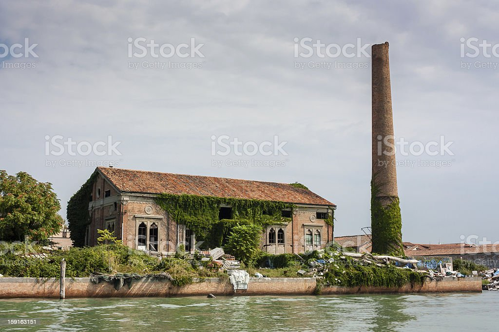 Overgrown abandoned factory on an island in the Venetian lagoon royalty-free stock photo