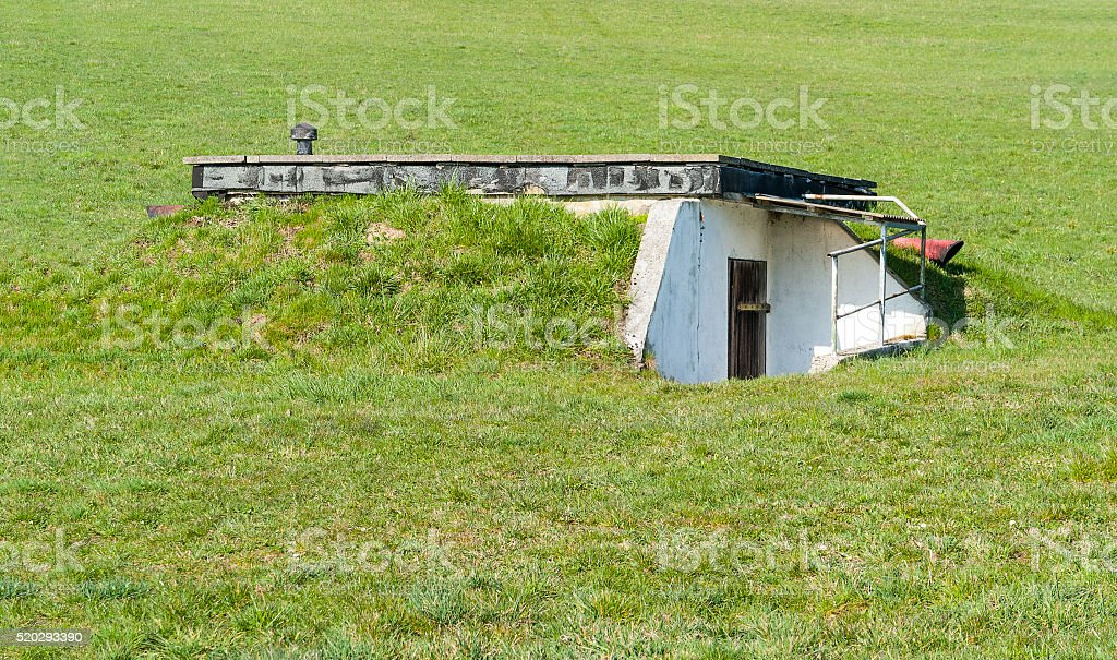 overgrown bunker stock photo